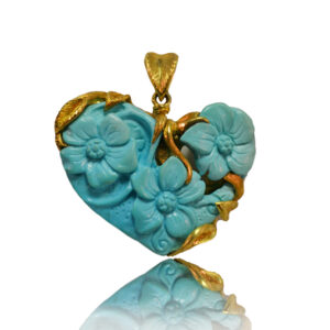 Pendant in yellow gold with turquoise, the pendant is double-faced and unique in every detail